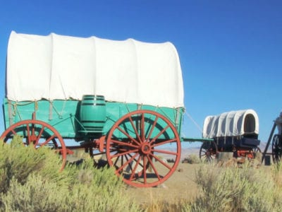 A covered wagon train forms a protective circle to camp along the Oregon Trail in eastern Oregon.